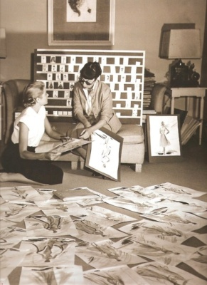 Edith Head and Grace Kelly going over costume sketches for To Catch a Thief: http://moviestarmakeover.com/2012/10/06/edith-headquarters/