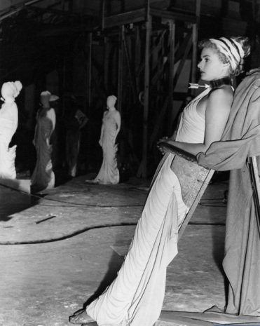 Bergman on a leaning board via: http://whybuyart.blogspot.com/2012/03/salvador-dali-and-ingrid-bergman-on-set.html