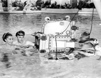 via: http://acertaincinema.pemomo.com/browse/person/esther-williams/?p1=1&p2=1&p3=1&p4=1 Esther, director George Sidney, and camera man on the set of Jupiter's Darling