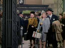 Sonja Henie clutches a train case in It's a Pleasure
