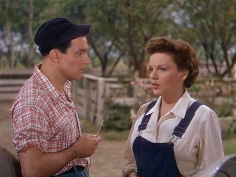 his cap matches her overalls