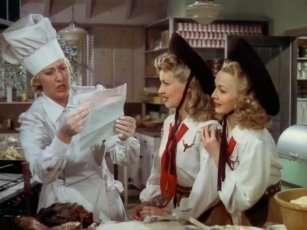 A cook and two waitresses in Moon Over Miami