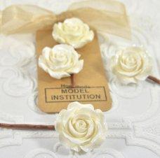 https://www.etsy.com/listing/562597918/white-flower-hair-clip-white-resin?ref=shop_home_active_45